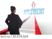 Implement against red arrow with steps graphic. Стоковое фото, агентство Wavebreak Media / Фотобанк Лори