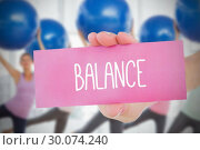 Купить «Woman holding pink card saying balance», фото № 30074240, снято 21 марта 2014 г. (c) Wavebreak Media / Фотобанк Лори