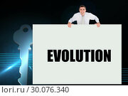 Купить «Businessman holding card saying evolution», фото № 30076340, снято 22 марта 2014 г. (c) Wavebreak Media / Фотобанк Лори