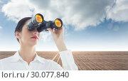 Купить «Composite image of business woman looking through binoculars», фото № 30077840, снято 25 марта 2014 г. (c) Wavebreak Media / Фотобанк Лори