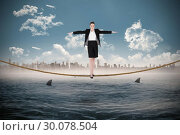 Купить «Composite image of businesswoman performing a balancing act», фото № 30078504, снято 28 марта 2014 г. (c) Wavebreak Media / Фотобанк Лори