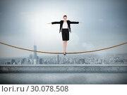 Купить «Composite image of businesswoman performing a balancing act», фото № 30078508, снято 28 марта 2014 г. (c) Wavebreak Media / Фотобанк Лори