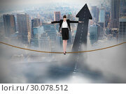 Купить «Composite image of businesswoman performing a balancing act», фото № 30078512, снято 28 марта 2014 г. (c) Wavebreak Media / Фотобанк Лори