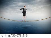 Купить «Composite image of businesswoman performing a balancing act», фото № 30078516, снято 28 марта 2014 г. (c) Wavebreak Media / Фотобанк Лори