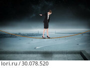 Купить «Composite image of businesswoman performing a balancing act», фото № 30078520, снято 28 марта 2014 г. (c) Wavebreak Media / Фотобанк Лори