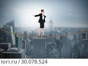 Купить «Composite image of businesswoman performing a balancing act», фото № 30078524, снято 28 марта 2014 г. (c) Wavebreak Media / Фотобанк Лори