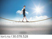 Купить «Composite image of businesswoman doing a balancing act», фото № 30078528, снято 28 марта 2014 г. (c) Wavebreak Media / Фотобанк Лори