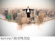 Купить «Composite image of businesswoman performing a balancing act», фото № 30078532, снято 28 марта 2014 г. (c) Wavebreak Media / Фотобанк Лори