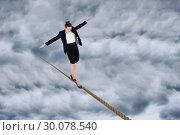 Купить «Composite image of businesswoman performing a balancing act», фото № 30078540, снято 28 марта 2014 г. (c) Wavebreak Media / Фотобанк Лори