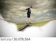 Купить «Composite image of businesswoman performing a balancing act», фото № 30078564, снято 28 марта 2014 г. (c) Wavebreak Media / Фотобанк Лори