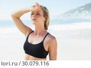 Купить «Fit blonde wiping her forehead on the beach», фото № 30079116, снято 14 февраля 2014 г. (c) Wavebreak Media / Фотобанк Лори