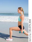 Купить «Fit woman doing weighted lunges on the beach», фото № 30079304, снято 14 февраля 2014 г. (c) Wavebreak Media / Фотобанк Лори