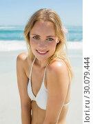 Купить «Beautiful blonde in white bikini smiling at camera on the beach », фото № 30079444, снято 14 февраля 2014 г. (c) Wavebreak Media / Фотобанк Лори