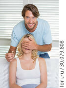 Купить «Handsome man covering his girlfriends eyes about to propose», фото № 30079808, снято 24 января 2014 г. (c) Wavebreak Media / Фотобанк Лори