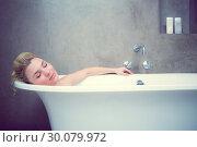 Купить «Serene blonde lying in the bath», фото № 30079972, снято 24 января 2014 г. (c) Wavebreak Media / Фотобанк Лори