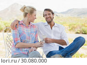 Купить «Cute couple sitting in the garden enjoying wine together», фото № 30080000, снято 24 января 2014 г. (c) Wavebreak Media / Фотобанк Лори
