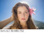 Купить «Beautiful blonde with flower hair accessory on the beach», фото № 30080732, снято 12 февраля 2014 г. (c) Wavebreak Media / Фотобанк Лори