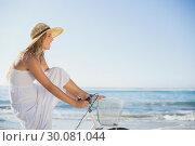 Купить «Beautiful blonde in white sundress on bike ride at the beach», фото № 30081044, снято 12 февраля 2014 г. (c) Wavebreak Media / Фотобанк Лори
