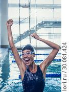 Купить «Excited swimmer jumping up the swimming pool», фото № 30081424, снято 26 февраля 2014 г. (c) Wavebreak Media / Фотобанк Лори