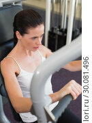 Купить «Fit brunette using weights machine for arms», фото № 30081496, снято 26 февраля 2014 г. (c) Wavebreak Media / Фотобанк Лори