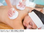 Купить «Smiling woman getting a back massage with herbal compresses», фото № 30082004, снято 9 апреля 2014 г. (c) Wavebreak Media / Фотобанк Лори