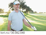 Купить «Smiling handsome golfer looking ahead», фото № 30082040, снято 3 апреля 2014 г. (c) Wavebreak Media / Фотобанк Лори