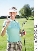 Купить «Female golfer standing and pointing up», фото № 30082124, снято 3 апреля 2014 г. (c) Wavebreak Media / Фотобанк Лори