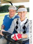 Купить «Happy golfing couple sitting in golf buggy smiling at camera», фото № 30082924, снято 3 апреля 2014 г. (c) Wavebreak Media / Фотобанк Лори