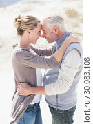 Купить «Happy hugging couple on the beach looking at each other», фото № 30083108, снято 3 апреля 2014 г. (c) Wavebreak Media / Фотобанк Лори