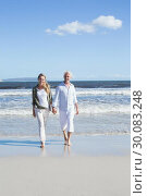 Купить «Happy couple strolling barefoot on the beach», фото № 30083248, снято 3 апреля 2014 г. (c) Wavebreak Media / Фотобанк Лори