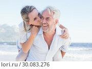Купить «Man giving his smiling wife a piggy back at the beach», фото № 30083276, снято 3 апреля 2014 г. (c) Wavebreak Media / Фотобанк Лори