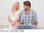 Купить «Happy couple sitting on floor using laptop», фото № 30083508, снято 24 января 2014 г. (c) Wavebreak Media / Фотобанк Лори