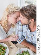 Купить «Happy couple enjoying a meal together», фото № 30083516, снято 24 января 2014 г. (c) Wavebreak Media / Фотобанк Лори