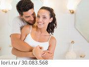 Купить «Attractive couple hugging in their pajamas», фото № 30083568, снято 29 января 2014 г. (c) Wavebreak Media / Фотобанк Лори