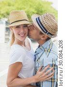 Купить «Young hip couple hugging and smiling at camera», фото № 30084208, снято 19 февраля 2014 г. (c) Wavebreak Media / Фотобанк Лори