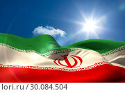 Купить «Iran national flag under sunny sky», фото № 30084504, снято 27 мая 2014 г. (c) Wavebreak Media / Фотобанк Лори