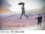Купить «Young businessman pulling a tightrope for business man», фото № 30086048, снято 11 июня 2014 г. (c) Wavebreak Media / Фотобанк Лори
