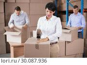 Купить «Warehouse workers packing up boxes», фото № 30087936, снято 10 мая 2014 г. (c) Wavebreak Media / Фотобанк Лори
