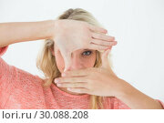 Купить «Woman making frame with her hands», фото № 30088208, снято 29 апреля 2014 г. (c) Wavebreak Media / Фотобанк Лори