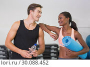 Купить «Personal trainer and client smiling at each other», фото № 30088452, снято 5 марта 2014 г. (c) Wavebreak Media / Фотобанк Лори