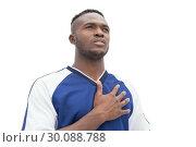 Football player in blue listening to anthem. Стоковое фото, агентство Wavebreak Media / Фотобанк Лори
