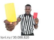 Купить «Serious referee showing yellow and red card», фото № 30088820, снято 24 апреля 2014 г. (c) Wavebreak Media / Фотобанк Лори