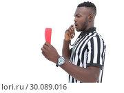 Купить «Serious referee showing red card», фото № 30089016, снято 24 апреля 2014 г. (c) Wavebreak Media / Фотобанк Лори