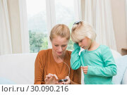 Купить «Happy mother and daughter listening to music», фото № 30090216, снято 10 июня 2014 г. (c) Wavebreak Media / Фотобанк Лори