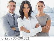 Купить «Serious businesswoman with folded arms», фото № 30090332, снято 6 мая 2014 г. (c) Wavebreak Media / Фотобанк Лори