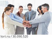 Купить «Business team stacking their hands», фото № 30090520, снято 6 мая 2014 г. (c) Wavebreak Media / Фотобанк Лори