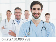 Купить «Smiling doctors all standing together», фото № 30090788, снято 6 мая 2014 г. (c) Wavebreak Media / Фотобанк Лори