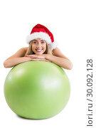 Купить «Festive fit blonde posing with exercise ball», фото № 30092128, снято 9 июля 2014 г. (c) Wavebreak Media / Фотобанк Лори