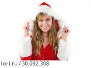 Купить «Festive blonde smiling at camera», фото № 30092308, снято 10 июля 2014 г. (c) Wavebreak Media / Фотобанк Лори