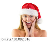 Купить «Festive blonde with hands on face», фото № 30092316, снято 10 июля 2014 г. (c) Wavebreak Media / Фотобанк Лори